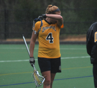 Bryant 8, Quinnipiac 6Quinnipiac's Devon Gibney wipes her head after Sunday's loss vs. Bryant.