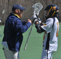 Quinnipiac 15, Wagner 5Quinnipiac's Campbell Puckett celebrates with head coach Eric Fekete after he scores his first-career goal in the fourth quarter of Saturday's game vs. Wagner.