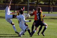 Monmouth players take advantage of Quinnipiac's Borja Angoitia's distance from the goal.