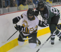 Quinnipiac 4, Mercyhurst 4Quinnipiac's Nicole Brown tries to play the puck from her knees in Friday's game vs. Mercyhurst.