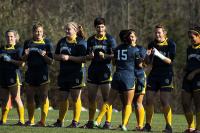 Quinnipiac's Elisa Cuellar high fives her teammates before Sunday's game begins.