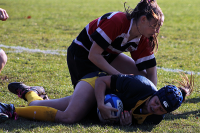 Quinnipiac's Jacquline Maclearie gets tackled during Sunday's game.