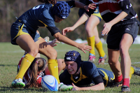 Quinnipiac players reach for the ball during Sunday's game.