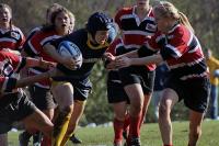 A Quinnipiac player runs through the Marist defense during Sunday's game.