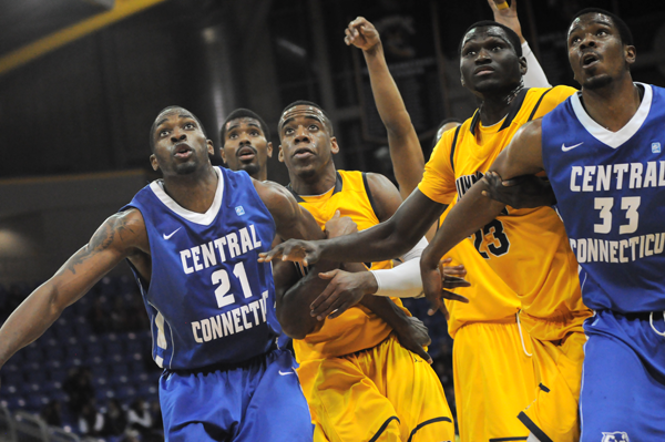 Quinnipiac 85, CCSU 78Quinnipiac and CCSU players vie for a rebound in Thursday's game.