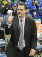 Quinnipiac 85, CCSU 78Quinnipiac head coach Tom Moore salutes the crowd after Thursday's game vs. CCSU.