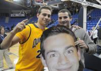 Quinnipiac 85, CCSU 78Quinnipiac's Evan Conti poses for a picture with a fan after Thursday's game vs. CCSU.