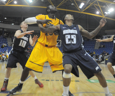 Quinnipiac 79, Monmouth 63Quinnipiac's Ousmane Drame boxes out for a rebound in Thursday's game vs. Monmouth.