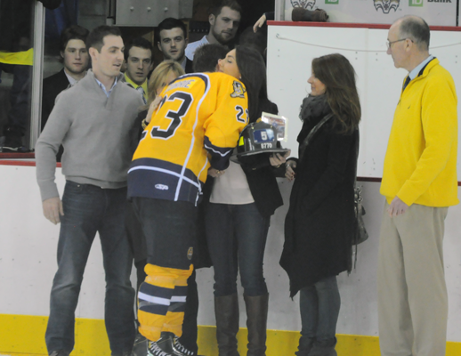 Quinnipiac 4, Yale 1Quinnipiac captain Zack Currie hugs the Mascali family after Quinnipiac wins the Heroes Hat by beating Yale on Friday.