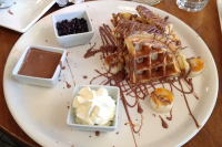 A traditional French-Canadian dessert, a banana-split waffle drizzled with delectable milk chocolate, enjoyed by many students on the trip.