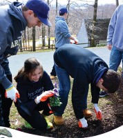 Students plant flowers at the Hopkins School in New Haven.