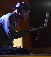Sophomore Fanonx Rogers DJs during the Rap Battle
