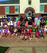 Two orientation leaders with their merged freshmen groups during Welcome Weekend.