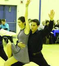 Senior Stephanie Azzarello and graduate student Alex Diaz dance during the annual Dancing with the QU Stars event.