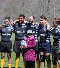 Lauren Loose (front) posed with sophomore Danny Holland, senior PJ Ruttura, sophomore Nik Griswold, senior Matt Sjanzar and senior Paul Thomspon at halftime during Sunday's charity game.