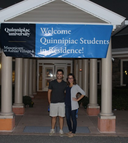 Joe Huberman and Victoria Kozar pose in front of the building they are living in at Ashlar assisted living facility.