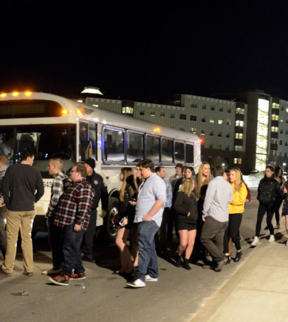 Students wait to board New Haven shuttle on the York Hill campus.