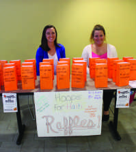 Marie Frey and Lauren Szmak run the Hoops for Haiti raffle table.