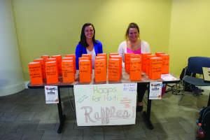 Marie Frey and Lauren Szmak run the Hoops for Haiti raffle table.