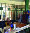 (From left to right) Imam Sami, Hamna Mahboob, Taqua Naeem, Annie Ishfaq and Ayah Galal serve pizza.
